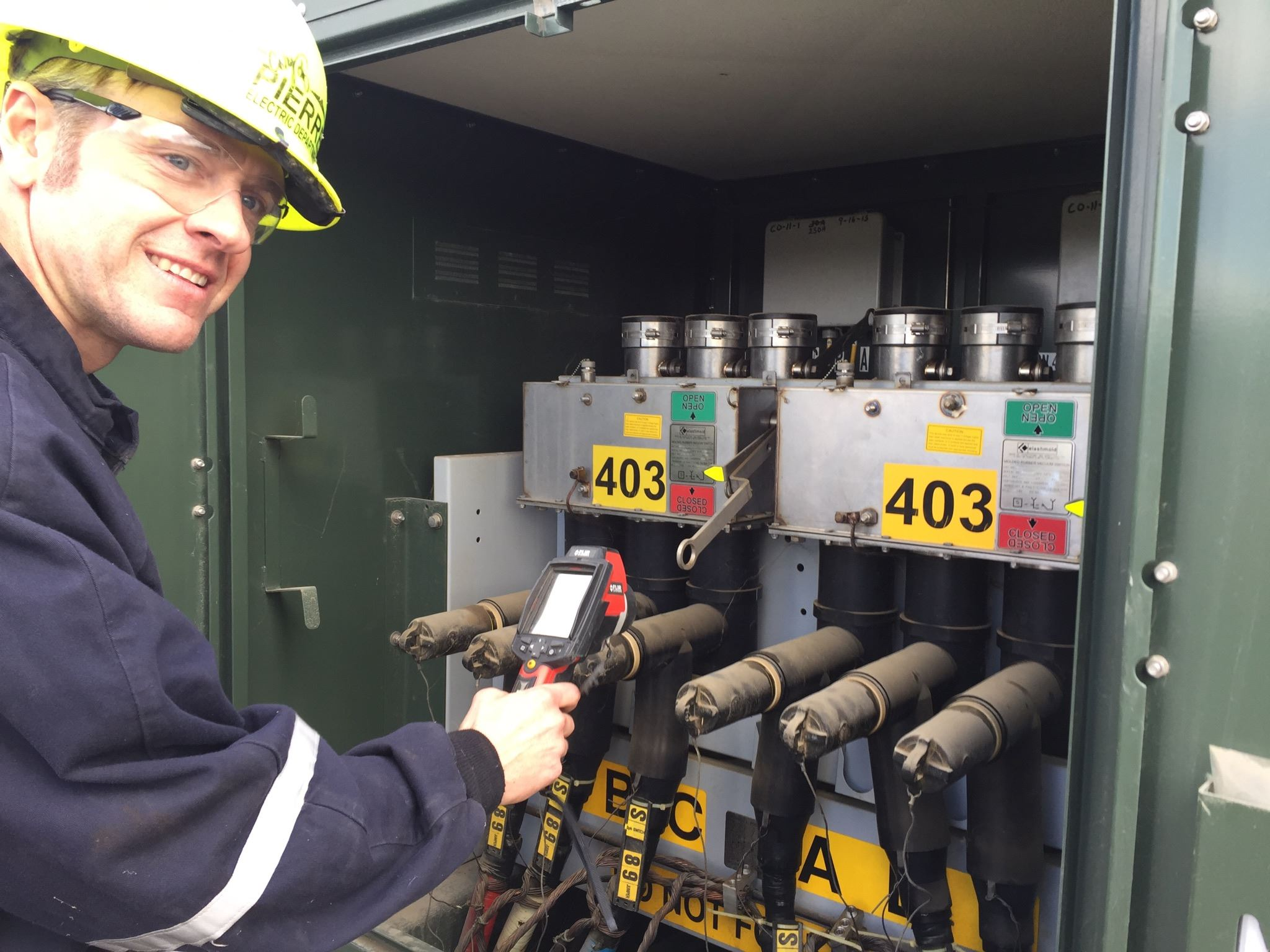 Electric Department Operations_Staff using Heat Gun